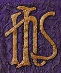 IHS. Jumalan. Karitsa. Ykstyiskohta kasukasta vuodelta 1914.